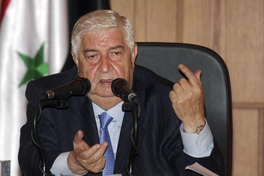 "Syrian Foreign Minister Walid Moallem speaks during a news conference in Damascus, Syria, on Wednesday, June 22, 2011, during which he vowed to present ""an unprecedented example of democracy"" in the country within three months. (AP Photo/Bassem Tellawi)"