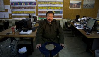 ** FILE ** Chinese artist and activist Ai Weiwei gives an interview at his studio in Beijing in January 2010. (AP Photo/Alexander F. Yuan, File)