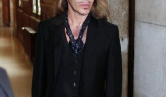 Former Dior designer John Galliano arrives at the Paris court house, Wednesday, June 22, 2011, charged with hurling anti-Semitic slurs in a Paris cafe — allegations that shocked the fashion world and cost him his job at the renowned French high-fashion house. (AP Photo/Thibault Camus)
