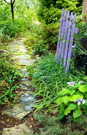Cottage gardens often feature quaint or comfortable accessories, such as a picket fence or stone pathway.