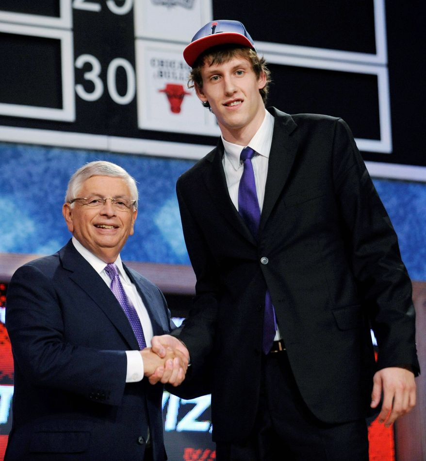 Jan Vesely, with NBA commissioner David Stern on Thursday, has been compared to Dallas' Dirk Nowitzki  and Utah's Andrei Kirilenko. (Associated Press)