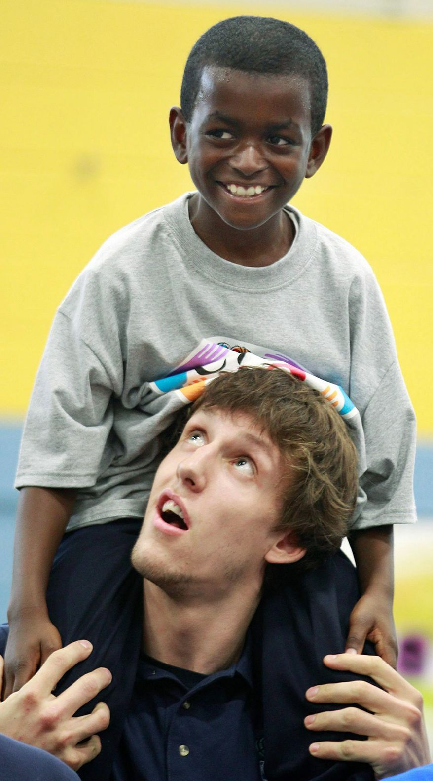 Keshawn Porter, above, 11, a member of the Boys & Girls Club in Newark, N.J., is seen on the shoulders of Jan Vesely, an NBA Draft prospect from the Czech Republic, at the end of an NBA Fit Clinic, Wednesday, June 22, 2011 in Newark, N.J. (AP Photo/Julio Cortez)