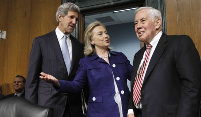 Secretary of State Hillary Rodham Clinton talks on June 23, 2011,with Senate Foreign Relations Committee Chairman John Kerry (left), Massachusetts Democrat, and the committee's ranking Republican, Sen. Richard Lugar of Indiana, on Capitol Hill prior to testifying before the committee on American policies in Afghanistan and Pakistan. (Associated Press)