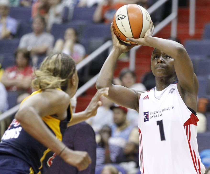 Washington Mystics' Crystal Langhorne (1) shoots the ball over Indiana Fever's Tamika Catchings, left, during the fourth quarter of a WNBA basketball game on Tuesday, June 21, 2011, in Washington. The Fever won 89-80, pushing the Mystics' losing skid to four games. (AP Photo/Luis M. Alvarez)