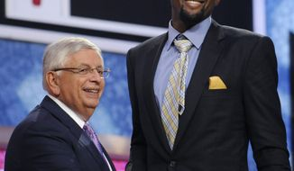 NBA Commissioner David Stern, left, poses with the No. 18 draft pick, Florida State's Chris Singleton, who was selected by the Washington Wizards in the NBA basketball draft Thursday, June 23, 2011, in Newark, N.J. (AP Photo/Bill Kostroun)