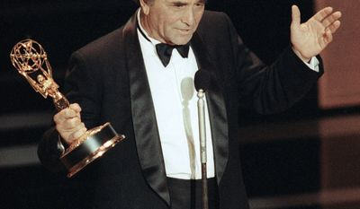 """** FILE ** In this Sept. 16, 1990, file photo, actor Peter Falk gestures as he accepts his the Emmy Award for Best Actor in a Drama for his role in the """"Columbo"""" series at the 42nd annual Emmy Awards in Pasadena, Calif. Falk died Thursday, June 23, 2011. (AP Photo/Nick Ut, file)"""