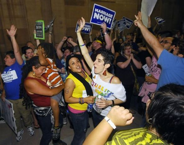 Supporters of same sex marriage celebrate after Senate members voted and approved same-sex marriage at the Capitol in Albany, N.Y., Friday, June 24, 2011. New York lawmakers narrowly voted to legalize same-sex marriage Friday, handing activists a breakthrough victory in the state where the gay rights movement was born. New York will become the sixth state where gay couples can wed and the biggest by far.(AP Photo/Hans Pennink)