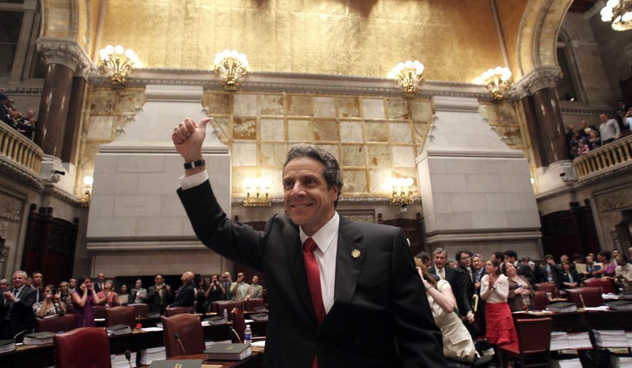 New York Gov. Andrew Cuomo reacts after gay marriage was legalized after a vote in the Senate Chamber at the Capitol in Albany, N.Y., on Friday, June 24, 2011. (AP Photo/Mike Groll)