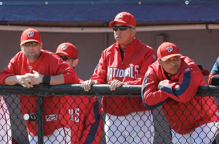 FILE - In this March 6, 2010, photo, Davey Johnson, second from right, a senior adviser for the Washington Nationals, stands in the dugout during a spring training baseball game against the New York Mets in Viera, Fla. Johnson was announced as the manager of the Nationals on Sunday, June 26, 2011, three days after Jim Riggleman stunned the team by resigning. Johnson will manage the rest of the season and his first game will be Monday against the Los Angeles Angels. (AP Photo/Rob Carr, File)