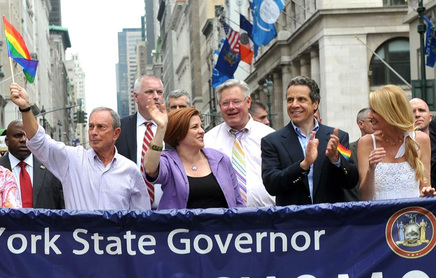 Mayor Michael Bloomberg, left, City Council Speaker Christine Quinn, second left, State Senator Tom Duane, center, Governor Andrew Cuomo, second right, and Cuomo's girlfriend Sandra Lee, right, walk in the annual Heritage of Pride March Sunday June 26, 2011, in New York.  The parade became a victory celebration after New York's historic decision to legalize same-sex marriage on Friday. (AP Photo/Diane Bondareff)