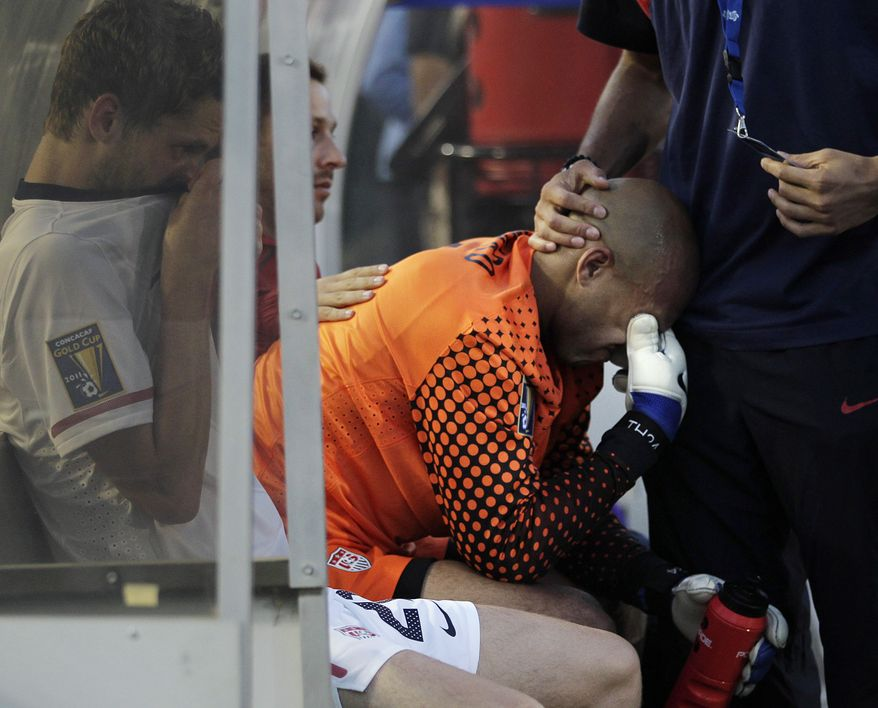 U.S. goalkeeper Tim Howard reacts after the U.S. lost the CONCACAF Gold Cup soccer final game against Mexico 4-2. (AP Photo/Jae C. Hong)