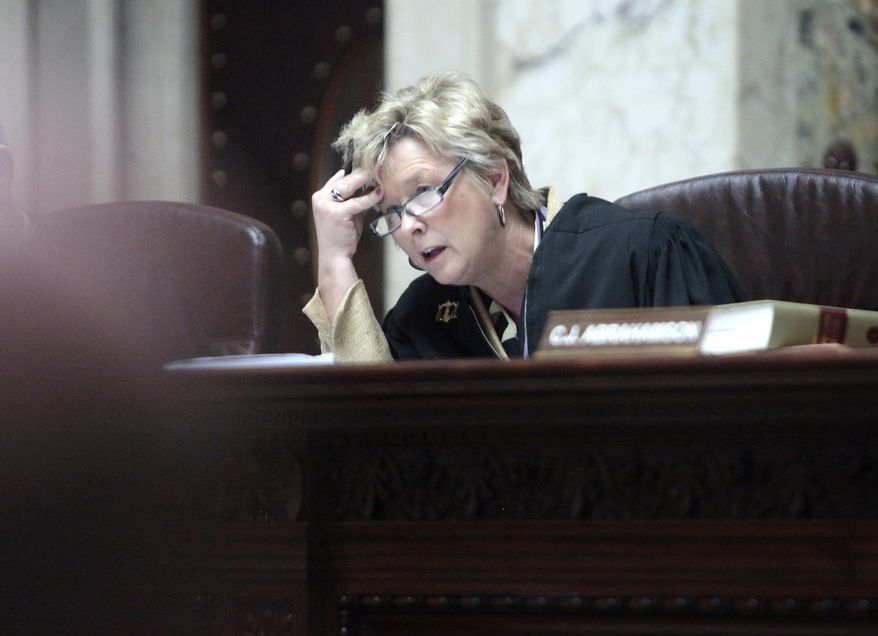 ** FILE ** Wisconsin Supreme Court Justice Ann Walsh Bradley listens to testimony at the Capitol in Madison, Wis., on Monday, June 6, 2011. (AP Photo/Wisconsin State Journal, John Hart, Pool)