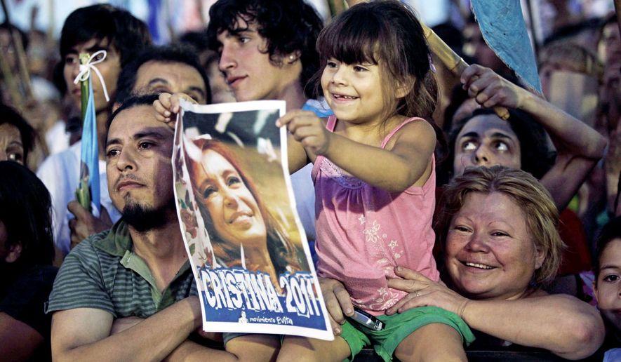 A girl holds a poster of Argentina's President Cristina Fernandez, who is favored to win a second term, during a political rally in Buenos Aires. (Associated Press)