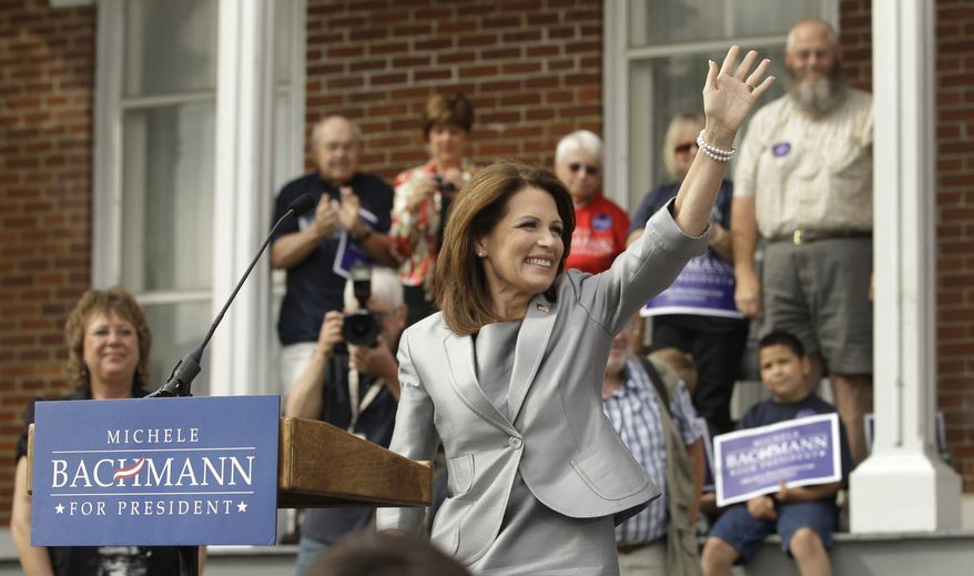 Rep. Michele Bachmann, Minnesota Republican, waves to the crowd as she officially announces her intent to seek the GOP presidential nomination on Monday, June 27, 2011, in Waterloo, Iowa. (AP Photo/Charlie Riedel)