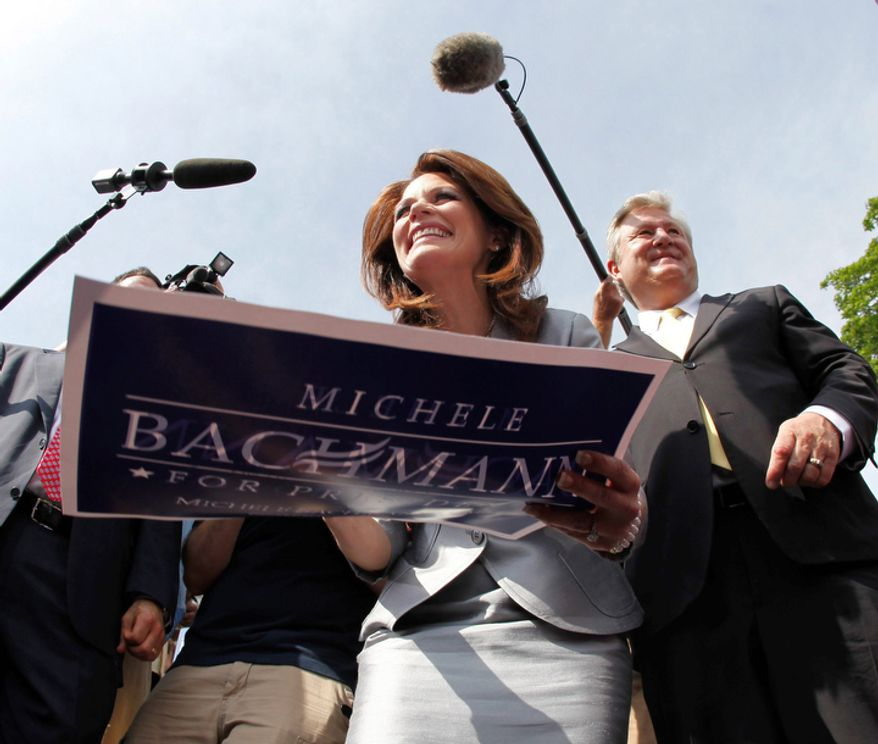 Rep. Michele Bachmann, R-Minn., accompanied by her husband Marcus, signs autographs in Waterloo, Iowa. Bachmann, who was born in Waterloo, will continue her announcement tour this week with stops in New Hampshire and South Carolina. (AP Photo/Charlie Riedel)