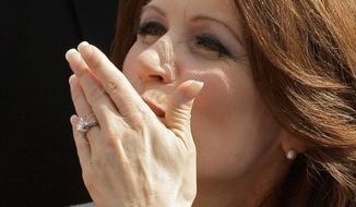 Rep. Michele Bachmann, R-Minn., blows a kiss to a supporter after her formal announcement to seek the 2012 Republican presidential nomination. (AP Photo/Charlie Riedel)