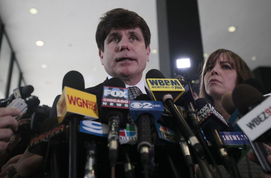 Former Illinois Gov. Rod Blagojevich speaks to the media at the Federal Courthouse in Chicago on June 27, 2011. Blagojevich has been convicted of 17 of the 20 charges against him, including all 11 charges related to his attempt to sell or trade President Obama's vacated Senate seat. At right is his wife Patti. (Associated Press)