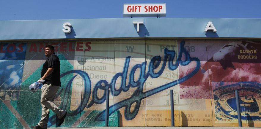**FILE** A man leaves the gift shop at Dodger Stadium, home of the Los Angeles Dodgers, on June 20, 2011, in Los Angeles. (Associated Press)