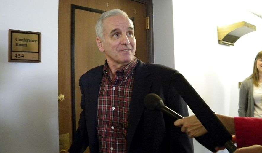 Minnesota Gov. Mark Dayton walks into a conference room ahead of negotiations with GOP leaders in efforts to avert a state government shutdown, Saturday, June 25, 2011, in St. Paul, Minn. (AP Photo/Martiga Lohn)