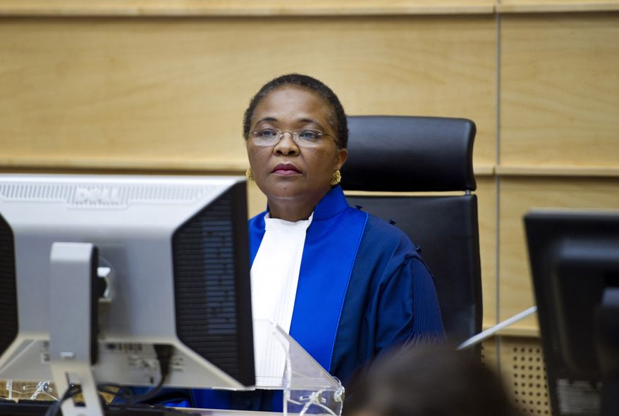 International Criminal Court Presiding Judge Sanji Mmasenono Monageng of Botswana is seen in the courtroom in The Hague on Monday, June 27, 2011, as the court issued arrest warrants for Libyan leader Col. Moammar Gadhafi, his son and his intelligence chief for crimes against humanity in the early days of their struggle to cling to power. (AP Photo/Robert Vos, Pool)