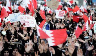 Bahraini anti-government protesters chant slogans in Manama, Bahrain in June, 2008. (Associated Press)