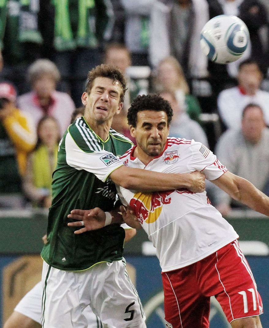 associated press Dwayne De Rosario (right), acquired from New York on Monday, scored a career-high 15 goals for Toronto FC in 2010.