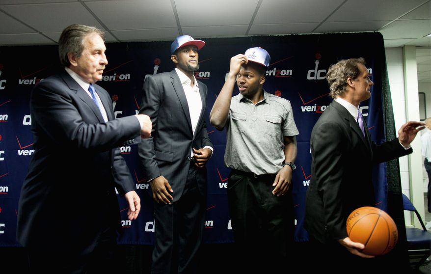 ** FILE ** Washington Wizards President Ernie Grunfeld (left) believes the team addressed needs by drafting Chris Singleton (second from left) and Shelvin Mack (second from right). At right is coach Flip Saunders.