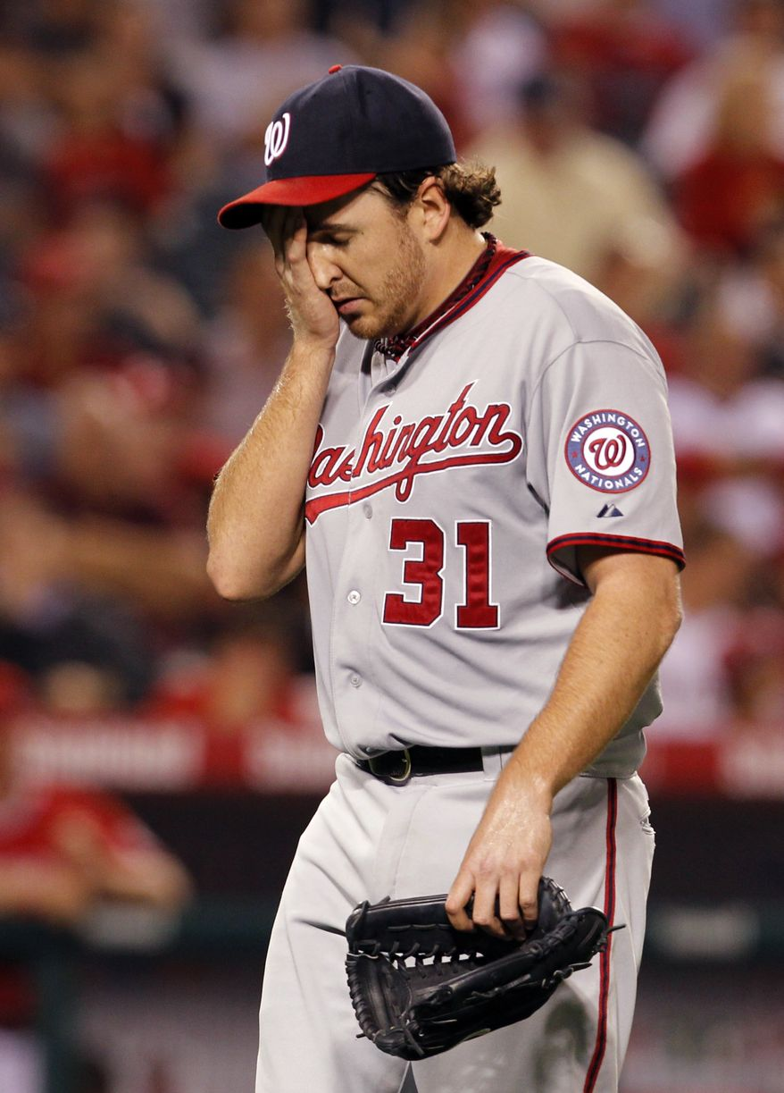 Washington Nationals pitcher John Lannan is taken out in the sixth inning of an interleague baseball game against the Los Angeles Angels in Anaheim Calif., on Monday, June 27, 2011. (AP Photo/Christine Cotter)