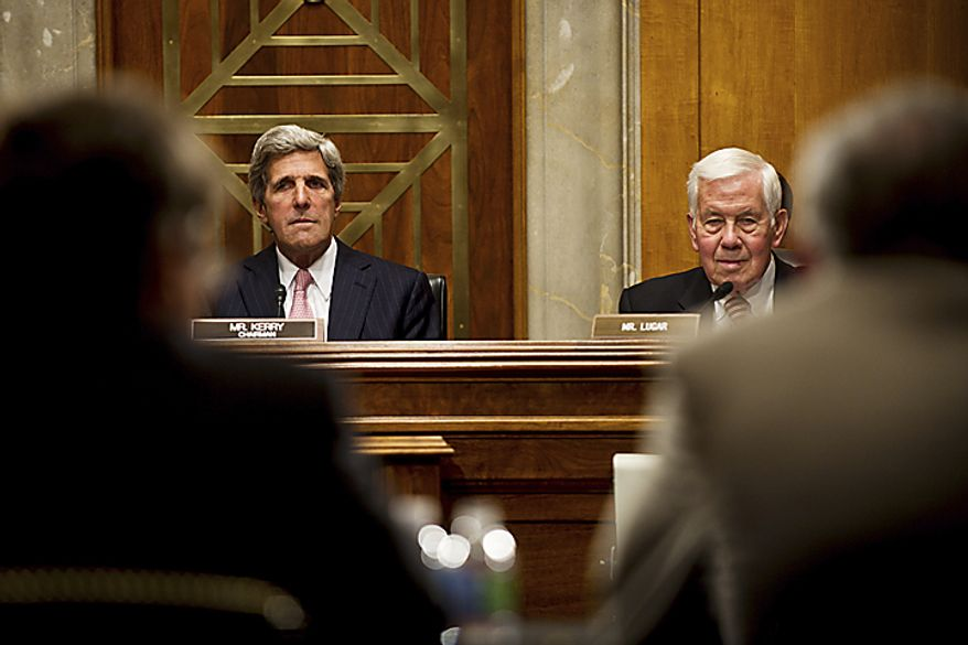 Sen. John Kerry (left), chairman of the Senate Foreign Relations Committee, and Sen. Richard G. Lugar, the ranking Republican on the panel, listen to testimony during a committee hearing on Libya and the War Powers Resolution on Capitol Hill in Washington on Tuesday, June 28, 2011. (Drew Angerer/The Washington Times)