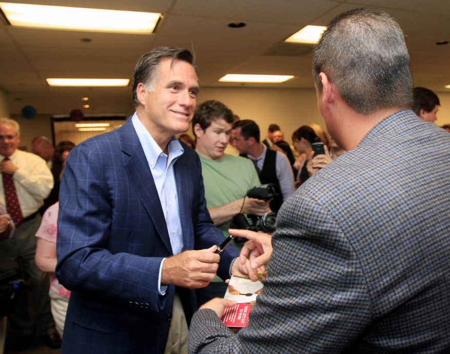 Former Massachusetts Gov. Mitt Romney, who is running for the 2012 Republican presidential nomination, meets with employees at Lincoln Financial in Concord, N.H., on Monday, June 27, 2011. (AP Photo/Jim Cole)