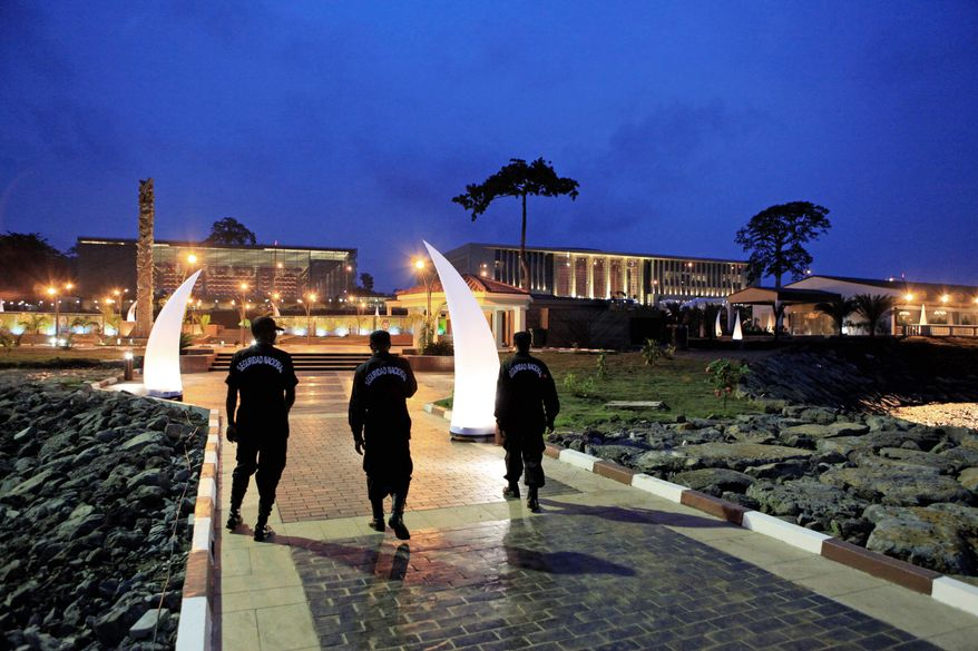 ASSOCIATED PRESS PHOTOGRAPHS Security guards for the 17th African Union summit, being held in Malabo, Equatorial Guinea, walk inside a luxury complex built for participants. It includes 52 luxury seaside villas, a man-made beach, high-end hotel and spa, golf course and conference center.