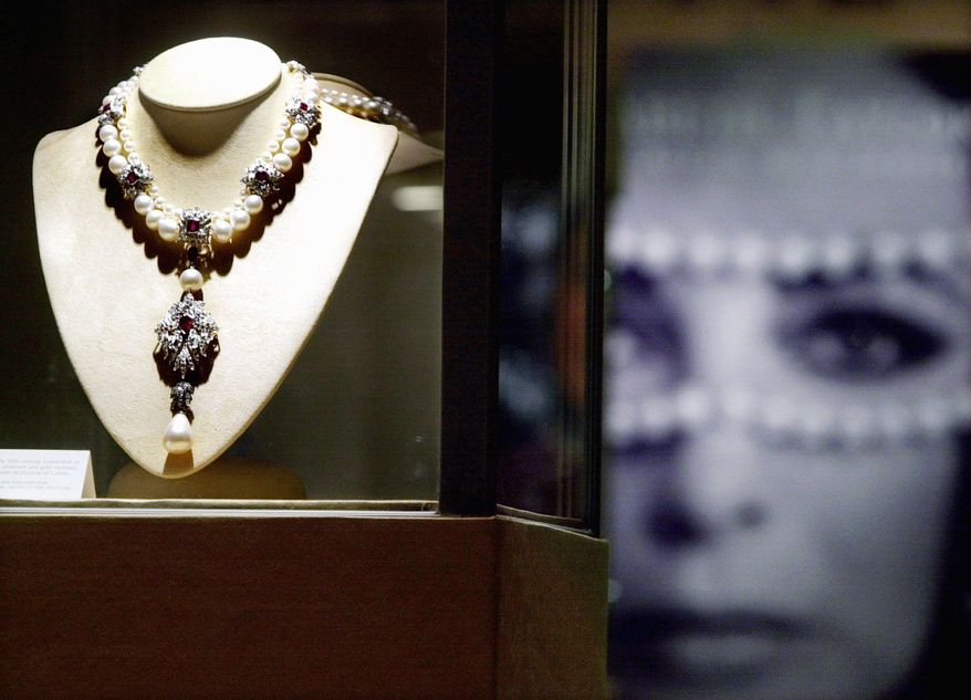 """CHRISTIE'S VIA ASSOCIATED PRESS Elizabeth Taylor had a self-professed """"love affair"""" with jewelry. Her jewels, art and designer clothing are touring internationally before going on auction.ASSOCIATED PRESS Among Elizabeth Taylor's jewelry is a necklace created to show off a drop pearl found by slaves in the Gulf of Panama in the early 1800s. In"""