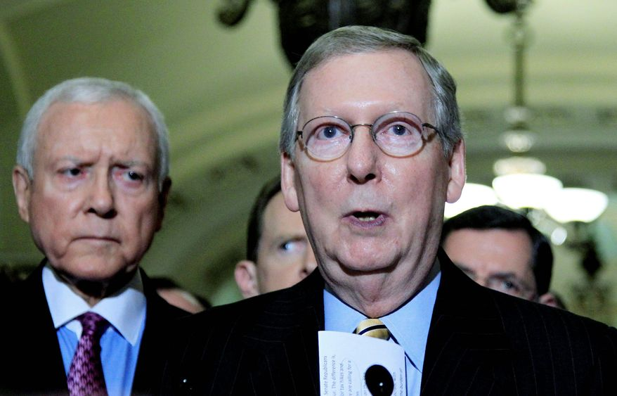 """""""If this week has shown us anything it's that the American people can't wait on Democrats to do the right thing when it comes to spending and debt and putting us on a path to balance the budget,"""" said Senate Minority Leader Sen. Mitch McConnell, Kentucky Republican. Sen. Orrin Hatch, Utah Republican (left), also spoke in favor of a balanced budget amendment. (Associated Press)"""