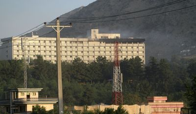 Smoke rises from the Inter-Continental hotel in Kabul, Afghanistan, on Wednesday, June 29, 2011, after it was attacked by militants. (AP Photo/Musadeq Sadeq)