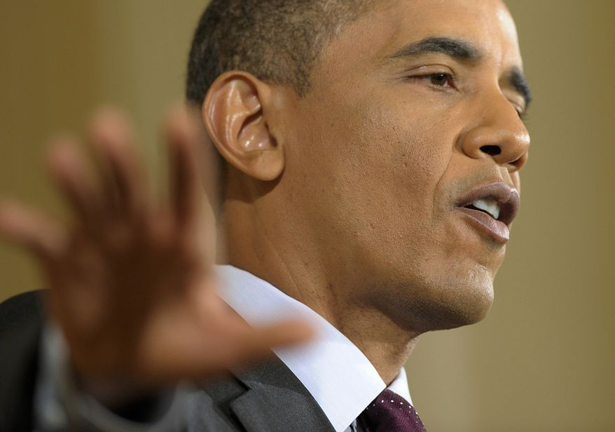 President Obama gestures during a news conference in the East Room of the White House on June 29, 2011. (Associated Press)