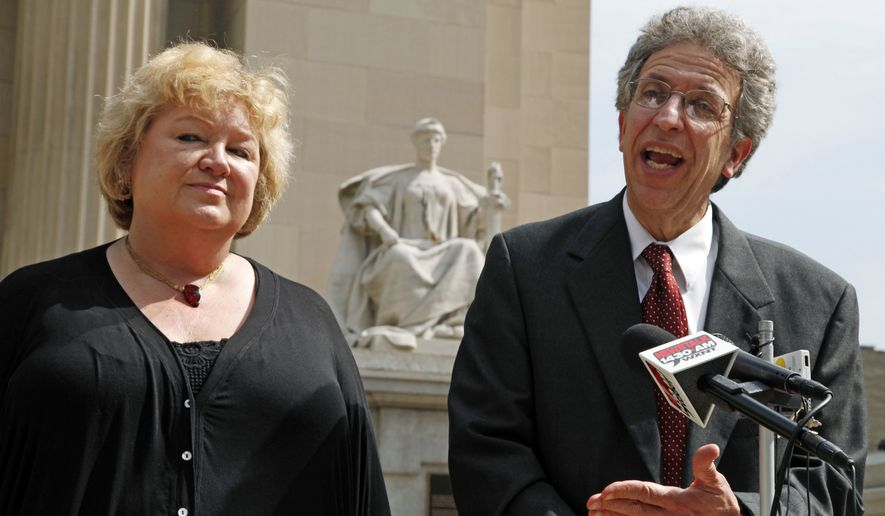** FILE ** Betty Cockrum, left, president of Planned Parenthood of Indiana and attorney Ken Faulk discuss a hearing in federal court where the group is seeking a injunction against a law ending most of their state funding, outside the Federal Courthouse in Indianapolis, Monday, June 6, 2011. (AP Photo/Michael Conroy)
