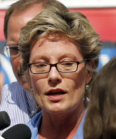 ** FILE ** Sue Swayze, a lobbyist for Indiana Right to Life, discusses a hearing in federal court where Planned Parenthood of Indiana is seeking a injunction against a law ending most of their state funding outside the Federal Courthouse in Indianapolis, Monday, June 6, 2011. (AP Photo/Michael Conroy