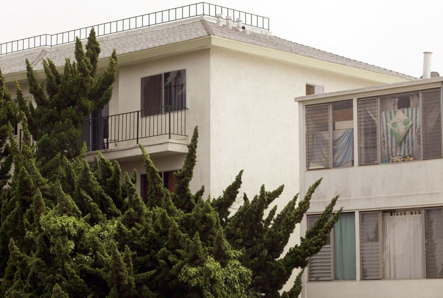 """Associated Press The top corner third-floor apartment (upper left) was where fugitive crime boss James """"Whitey"""" Bulger and longtime companion Catherine Greig were living in Santa Monica, Calif., at the time of their arrest June 22."""