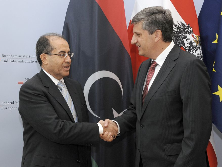 Austrian Foreign Minister Michael Spindelegger (right) welcomes Mahmoud Jibril, executive bureau chairman of the Transitional National Council in Libya, for talks in Vienna, Austria, on Thursday, June 30, 2011. (AP Photo/Hans Punz)