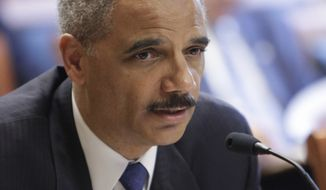 **FILE** Attorney General Eric Holder testifies June 1, 2011, before the U.S. Sentencing Commission at the Thurgood Marshall Federal Judiciary Building in Washington. (Associated Press)