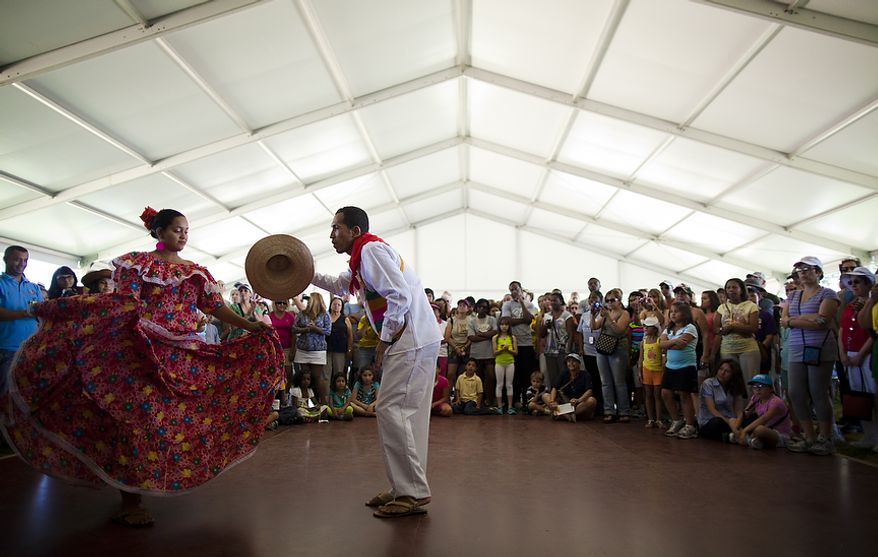 "A Colombian dance and music troupe performs at the ""Colombia: The Nature of Culture"" exhibit of the 45th annual Smithsonian Folklife Festival on the National Mall in Washington, D.C. on Thursday, June 30, 2011. The program highlighted Colombia's diverse cultural and natural heritage, featuring 100 participants from the country's six primary ecosystems and three major cities. (Pratik Shah/The Washington Times)"