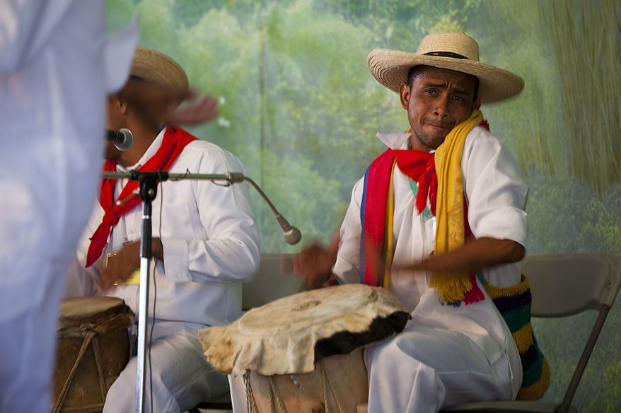 """A drummer with the Colombian dance and music troupe performs at the """"Colombia: The Nature of Culture"""" exhibit on opening day of the Smithsonian Folklife Festival on the National Mall in Washington, D.C. on Thursday, June 30, 2011. (Pratik Shah/The Washington Times)"""