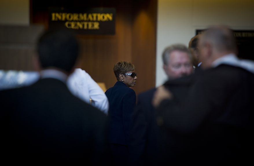 Prince George's County Councilwoman Leslie Johnson, 59, (in sun glasses) wife of former Prince George's County Executive Jack Johnson, arrives to enter her plea of guilty to the charge of conspiring to obstruct a federal corruption investigation, at the U.S. District Court in Greenbelt, Md., Thursday, June 30, 2011. (Rod Lamkey Jr/The Washington Times)