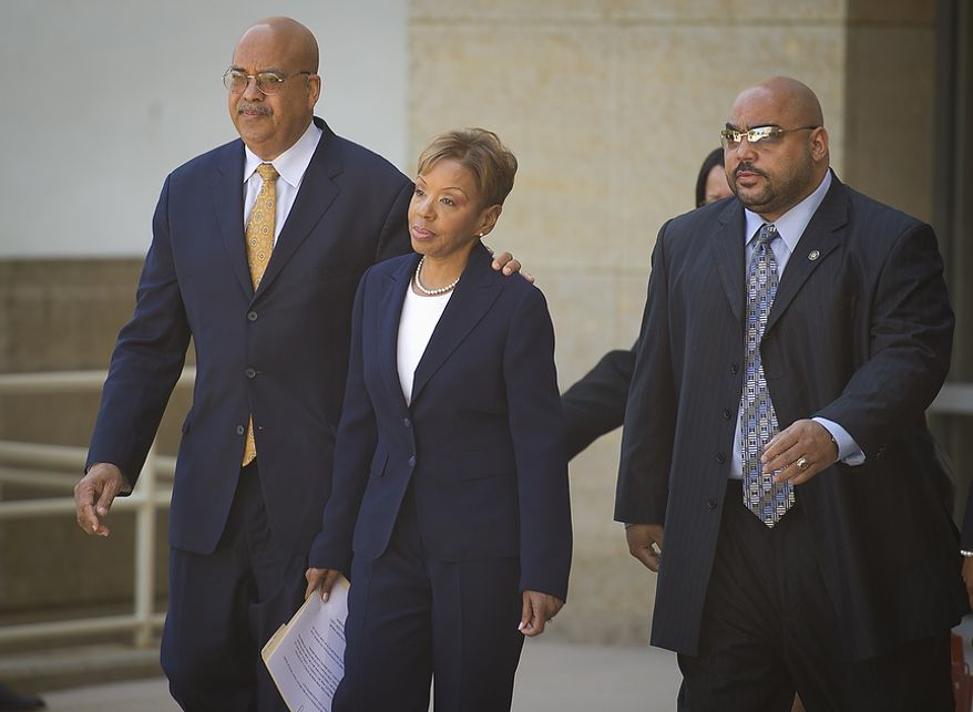 Prince George's County Councilwoman Leslie Johnson, 59, wife of former Prince George's County Executive Jack Johnson, makes her exit after entering her plea of guilty to the charge of conspiring to obstruct a federal corruption investigation, at the U.S. District Court in Greenbelt, Md., Thursday, June 30, 2011. (Rod Lamkey Jr/The Washington Times)