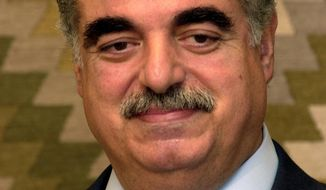 **FILE** In this photo from April 6, 2003, Lebanese Prime Minister designate Rafik Hariri speaks to reporters in Beirut after Lebanese President Emile Lahoud asked Hariri to form a new cabinet. Hariri was killed along with 22 other people in a massive truck bombing along Beirut's waterfront in 2005. (Associated Press)