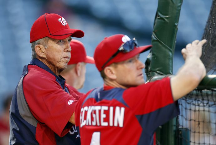 Washington Nationals manager Davey Johnson watches batting practice with batting coach Rick Eckstein before a game against the Los Angeles Angels in Anaheim Calif., on Monday, June 27, 2011. (AP Photo/Christine Cotter)