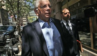 **FILE** NBA commissioner David Stern (left) and NBA spokesperson Mike Bass arrive in New York at a midtown hotel for a meeting with the players' union on June 30, 2011. (Associated Press)