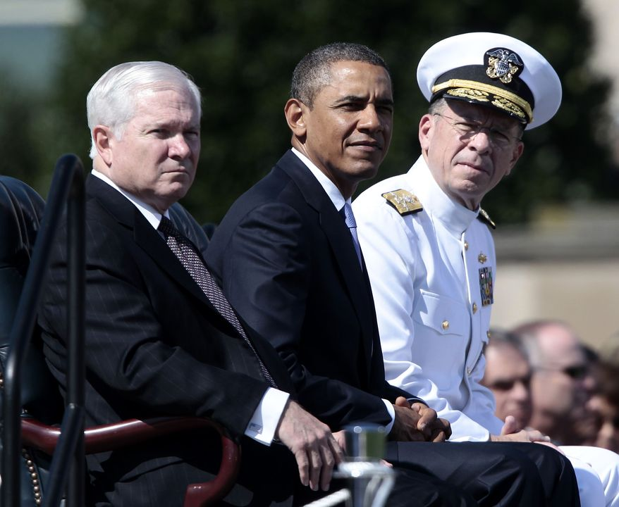President Obama (center) and Adm. Mike Mullen (right), chairman of the Joint Chiefs of Staff, sit with outgoing Defense Secretary Robert M. Gates during a tribute to Mr. Gates on June 30, 2011, at the Pentagon. (Associated Press)