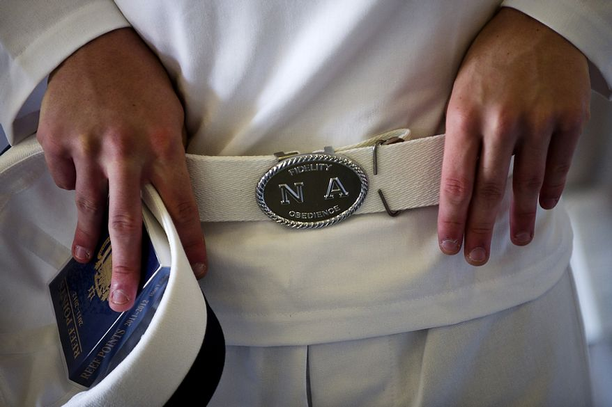 A U.S. Naval Academy plebe, or first-year student, adjusts his new Navy-issued belt in Alumni Hall during Induction Day at the academy in Annapolis on Thursday, June 30, 2011. The plebes are instructed to wear their uniforms with pride and to make sure everything is perfect on them. (Drew Angerer/The Washington Times)