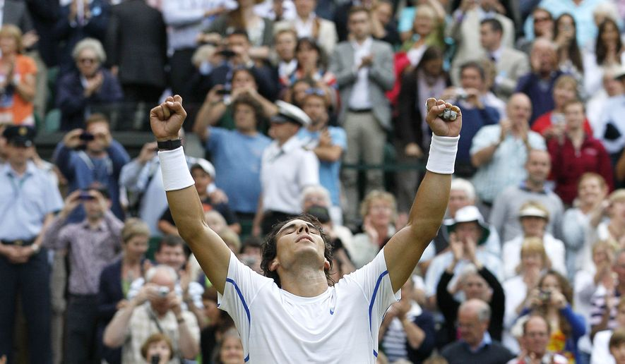 Spain's Rafael Nadal celebrates defeating Britain's Andy Murray in the men's semifinal match at the All England Lawn Tennis Championships at Wimbledon, Friday, July 1, 2011. (AP Photo/Kirsty Wigglesworth)